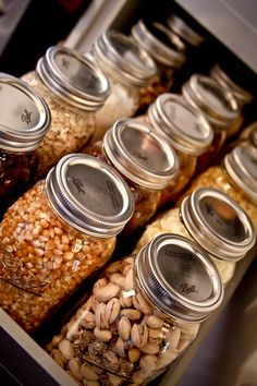Handy Ways to Use Mason Jars In Your Kitchen Store dry goods in quart-sized Mason jars for a cute and fun way to organize your pantry.Store dry goods in quart-sized Mason jars for a cute and fun way to organize your pantry. Canned Food Storage, Pantry Storage, Pantry Organization, Kitchen Storage, Mason Jar Storage, Pantry Diy, Bulk Food Storage Containers, Kitchen Containers, Glass Food Storage