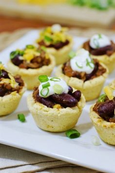 Chili Bites in Mini Cornbread Cups ~ turn chili into finger food with these tasty little chili cups. www.thekitchenismyplayground.com
