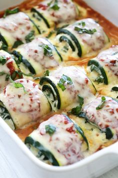 Zucchini Rollatini is low-carb and delicious! Made with strips of grilled zucchini stuffed with a basil-cheese filling, then rolled and topped with marinara, mozzarella and baked in the oven until the cheese is hot and melted.