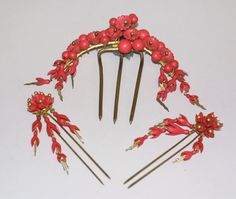 1850-1860  Dyed ivory and gold comb and matching hairpins. Ivory was often dyed to imitate coral.