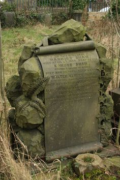 The ferns and ivy on this gravestone don't show  deterioration, yet the deaths were well over 100 years ago.
