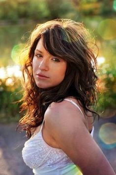 Long layered wavy curly hair with bangs   Hairstyles 2012