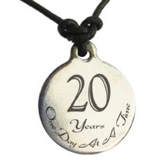 20 Year Sobriety Anniversary Medallion Leather Necklace for Sober Birthday, AA Alcoholics Anonymous, NA Narcotics Anonymous Serenity Is Forever. $20.99. Reads 20 Years One Day At A Time. For Men or Women. Engraved by Artist in Recovery with sharp, crisp black mark that is permanent and will not fade or chip. 100% brushed stainless steel on smooth genuine black leather cord. Other numbers available, seach SerenityIsForever medallion