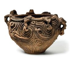 An earthenware vessel with sculptural rim, Late Jomon period (5th-3rd century BC)