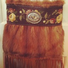 Made from another fur coat with vintage needle point added and backed in a suede child's vintage jacket