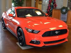 2015 Ford Mustang EcoBoost Premium in Competition Orange. Equipped with the 2.3L Turbo this Mustang can get up to 32 MPG on the highway. #FordMustang