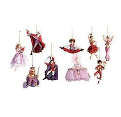 Bring the magic of the Nutcracker into your home with these beautifully hand-painted resin ornaments. Sure to become a family heirloom. Set of nine fi