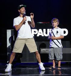 Singer Brian Littrell of the Backstreet Boys (L) and son singer Baylee Littrell appear on stage at the Gibson Amphitheatre on September 4, 2013 in Universal City, California.