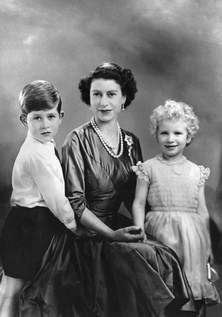 This undated picture shows Queen Elizabeth II posing for a photograph with young Prince Charles and Princess Anne, taken in an unknown locat...