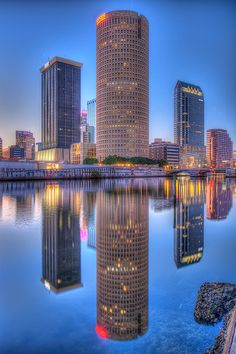 Tampa Towers Reflected in the Hillsborough River  - THE SYKES TOWER, WE CALL IT THE BEER CAN BLDG.