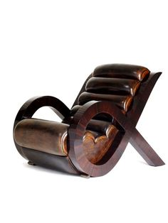 Lucca Chair by Jean de Merry. Love the chair itself, but not real hip on the padding/upholstery...