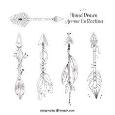 Set of ethnic hand drawn arrows Free Vector
