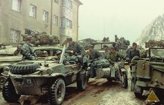 A Surrendered Schwimmwagen Kfz1 Type 166 (WH 1641890) and a BMW 75 Motor bike & side car with other vehicles of the 278. Infanterie Division (Wehrmacht) at the Brenner Pass, on the Italian – Austrian Border. May 1945.
