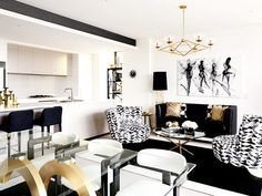 A strict black and white palette is punctuated by shimmering gold accents in this luxe space.
