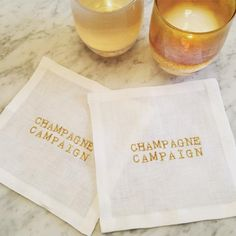 """Champagne Campaign Cocktail Square Set This is a campaign I can fully support. Show your love of Champagne with these adorable little squares. The quality of these little squares is extraordinary, its elegance will last for years and years with proper care. Made in the USA. Sold in a set of 4 Each square is 6"""" x 6"""" Made from white European linen Manufactured by our family owned and operated business in Redmond, WA. Machine wash using proper linen wash, lay flat to dry. Option to finish…"""