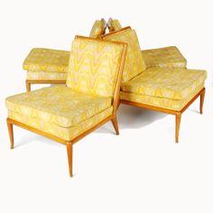 T.H. Robsjohn-Gibbings; Walnut Lounge Chairs for Widdicomb, 1950s.