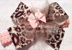 Hairbow, headband with feather puff & rhinestones, girly hair bow on Etsy, $12.99