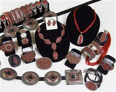 Navajo and Zuni jewelry with red coral.  http://www.oldtownjewels.com/Store-selection-of-coral-jewelry-p/coral-case-1.htm