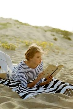 The perfect day, my own little private area on the beach, a book, and the waves rolling upon the shore as my soundtrack.