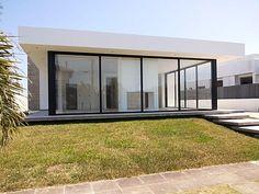 Casa térrea 4 suítes em condomínio horizontal, Luxo - Xangri-lá 57 | 4 dormitórios, 204M² - Xangri Lá, RS. Arquitetura contemporânea…