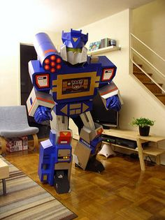 Real transformer costumes. They actually transform. Check out the video. Oh, and right about the video is a link to plans on how to make the costumes! This is awesome!