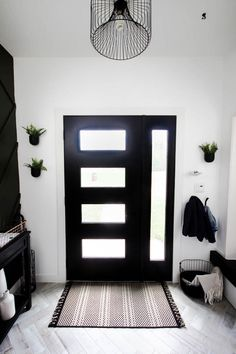 This gorgeous modern entryway reveal is here! What a huge transformation from the outdated space it once was! From the beautiful bench, to the herringbone floors, to the black front door, and the wood accent feature wall. This entry is stunning! Black Front Doors, Modern Front Door, Black Door, Door Design, House Design, Modern Exterior Doors, Wall Exterior, Front Door Entrance, Front Entry
