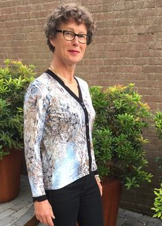 Sonja combined a t-shirt and a button up sweater to create a fab new cardigan! Grab her how-to over on Sewing a la Carte: Got a groovy refashion to share? How about a funky upcycled accessory or de…
