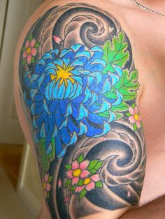 A blue chrysanthemum will be my next flower tattoo to go with my peony