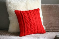 red hand knitted pillow