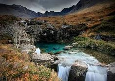 The Fairy Pools is located in Cuillins Hills, Isle of Skye, Scotland. The Fairy Pools are a series of clear, cold pools and waterfalls form...