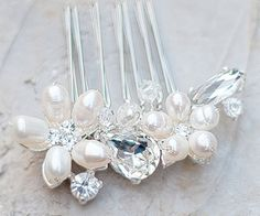 AA-S2317      $52.00  Small Pearl and Rhinestone Flower Bridal Hair Comb  Measures 2 in long, 3/4 in wide