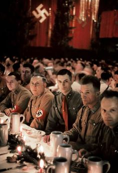 On December Hitler attended a Christmas party in Munich. These images were captured by Hugo Jaeger, Hitler's personal photographer, who buried the photographs near Munich after the war,. World History, World War Ii, Ww2 History, Workers Party, Germany Ww2, The Third Reich, Military History, Munich, Wwii