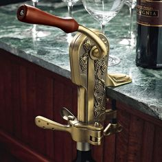 Table-mount corkscrew with a weathered gold- finish and hand crank.   Product: CorkscrewConstruction Material: Te...