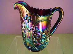 Beautiful and rare piece of Imperial carnival glass. A milk pitcher in the Windmill pattern.