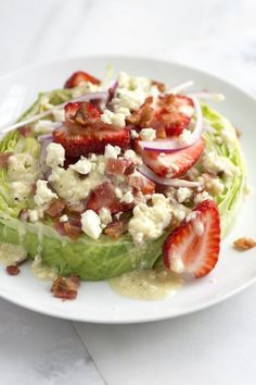 Iceberg Strawberry Salad  Ingredients 5 thick-cut bacon slices, cooked until crispy, crumbled 1-pound head (450 g) iceberg lettuce, trimmed and cored, sliced into 1-inch-thick rounds (should get about 4 to 5 rounds) 6 ounces (170 g) strawberries, hulled and sliced (9 strawberries) 1/4 medium red onion, thinly sliced Tangy Blue Cheese Vinaigr
