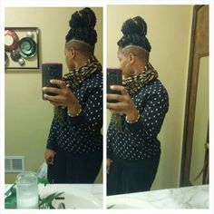 Shaved sides and back cut with a hard line. Natural tapered hair. Havana twist.