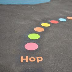Kids follow instructions to hop, skip, run on the playground to follow the activity trail.