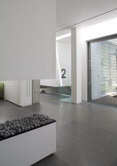 eHouse is a single family house that borrows from two traditions in architecture - a Mediterranean aesthetic of sun and light and a minimalist. Grey Flooring, Floors, Minimalist Architecture, Modern Spaces, Bathroom Interior Design, Minimalist Home, New Homes, House Design, Architects