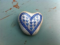 Blue & white heart on stone.