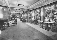 "The First Class Galerie – connecting Lounge forward with Library aft – of the Liberté, flagship of The French Line. 1950. Correcting an oversight original to the Europa, the Writing/Correpondence function formerly located within the Library was relocated here, thus imbuing what had been a sterile expanse with a thriving sense of life. Note on the right the four oil-on-linoleum panels, a series entitled ""The Art and Education of Man"". Image courtesy the private collection of John…"