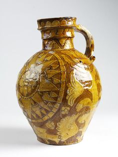 "1764 British Jug at the Victoria and Albert Museum, London - From the curators' comments: ""Big harvest jugs were a speciality of the potteries in the Barnstaple-Bideford area in north Devon. Traditionally, cider was brought out to thirsty harvesters in the fields. A compass design was often incised through the white clay slip of these jugs. This reflects the maritime importance of these West Country towns."""