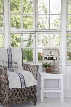 old windows framed as porch wall