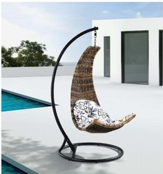 """Dais - Modern Balance Curve Porch Swing Chair Model - Y9073 by Chans Patio. $399.00. Simple assembly required. Seat size: 29 x 30 x 53""""H. Plain off white water-mimicking fabric cushion (different than photo shown). Heavy Duty Spring provided for added comfort (Max. carrying weight 250 LB.). 77"""" from floor to the tip of the hanging post (Hanging post inclusive in price). Enjoy the open-air of sunshine or moonlight on your deck or patio with the modern balance curve. The..."""
