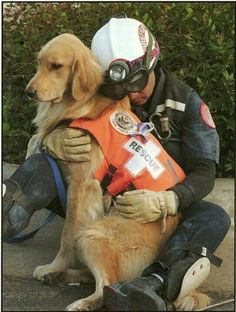 Man hugs the dog who helped him rescue people from a fire, you are both heroes!