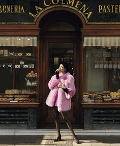 Posing outside of a pastry shop, Hanaa Ben Abdesslem wears pink Gucci fur coat
