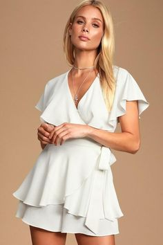 The Aldrin White Ruffled Backless Wrap Skort Romper is the perfect alternative to your basic LWD! Lightweight woven fabric creates this ruffled skort romper. Dressy Rompers And Jumpsuits, Cute Rompers, Jumpsuits For Women, White Skort, White Romper, Skort Dress, Wrap Skort, Grad Dresses, Casual Dresses