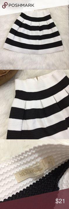 Neslay designer black and white skirt Size medium, half zip up the back. Super cute skater skirt. Great for fall time. Like new! neslay design Skirts Circle & Skater