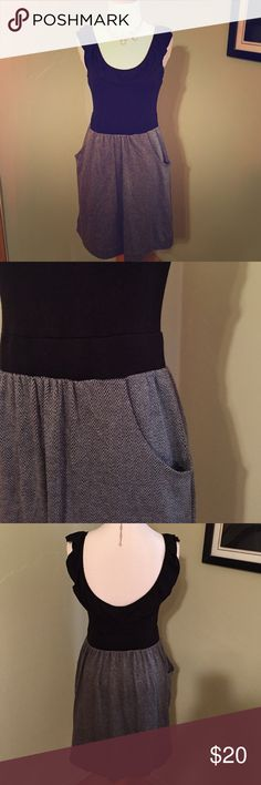 Anthropologie dress! Gray and black dress with two front pockets and a scooped back. The skirt is lined and thick. Good condition. Anthropologie Dresses