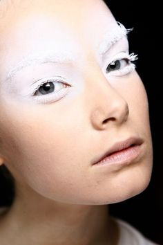 white makeup - like a puff of powder on the eyes & eye brows!