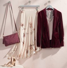 Mixing textures is a must-do this fall. A flowing floral skirt (taking a cue from your summer style) paired with a rich burgundy blazer is the perfect combination to head into cooler temps. Featured product includes: LC Lauren Conrad velvet blazer, asymmetrical floral skirt, lace-trim camisole, leather convertible clutch and high heels. Pretty up your fall style at Kohl's.